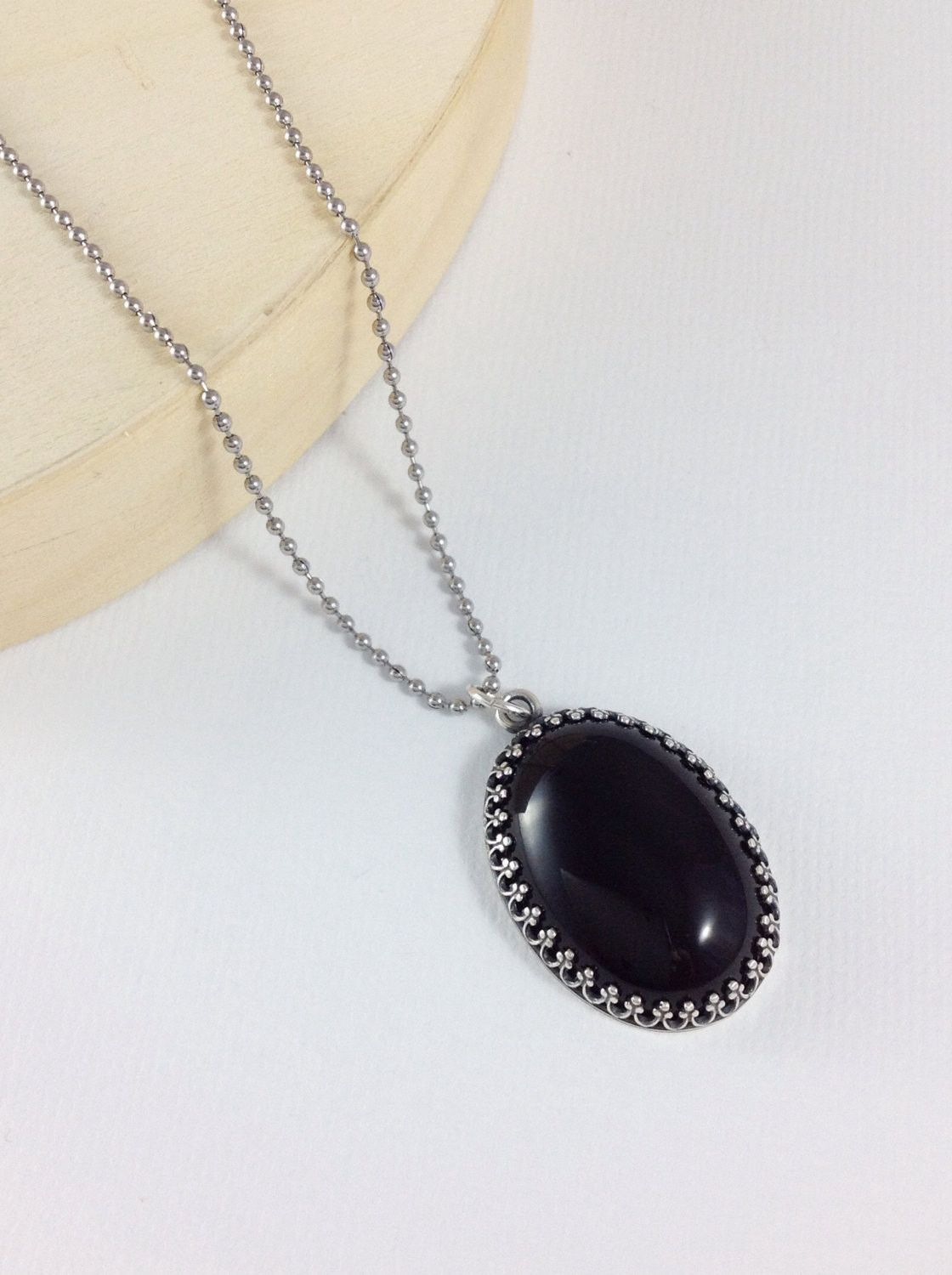 black necklace on ruby claw chains raven hematite onyx pave pendant