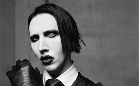 marilyn manson is a role model for me.the reason why is because he tries to let people think an do for themselves than to follow or listen to other people in society.hes a free spirit but also mysterious in a way that no other person would understand.
