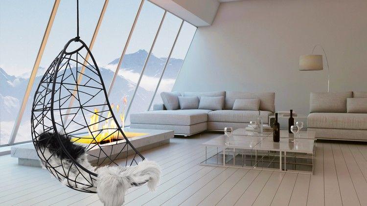 Hängesessel in einem geräumigen Wohnzimmer mit Bioethanol Kamin ...