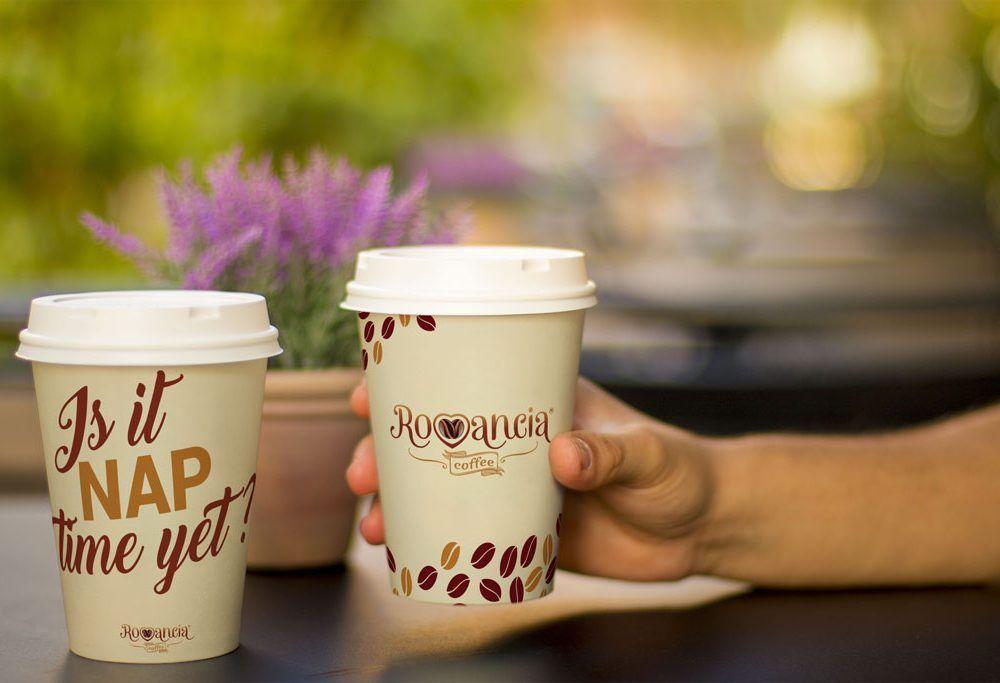 Holding a Coffee Cup Mockup   MockupWorld
