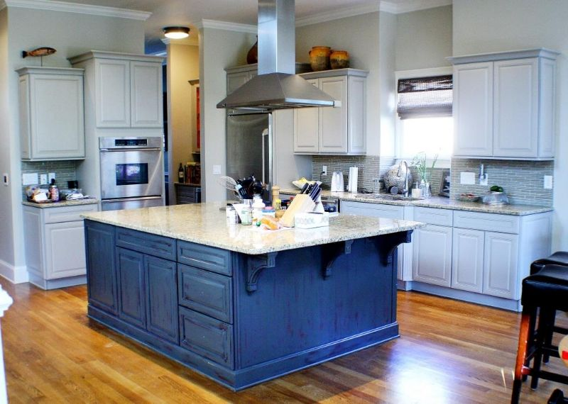 Blue Distressed Kitchen Cabinets With Wood Flooring