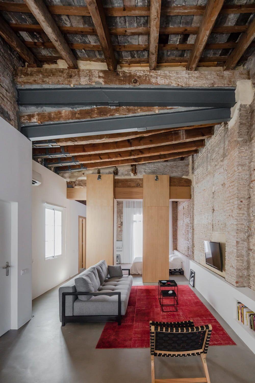 Exposed brick walls apartment by roberto di donato valencia design visual
