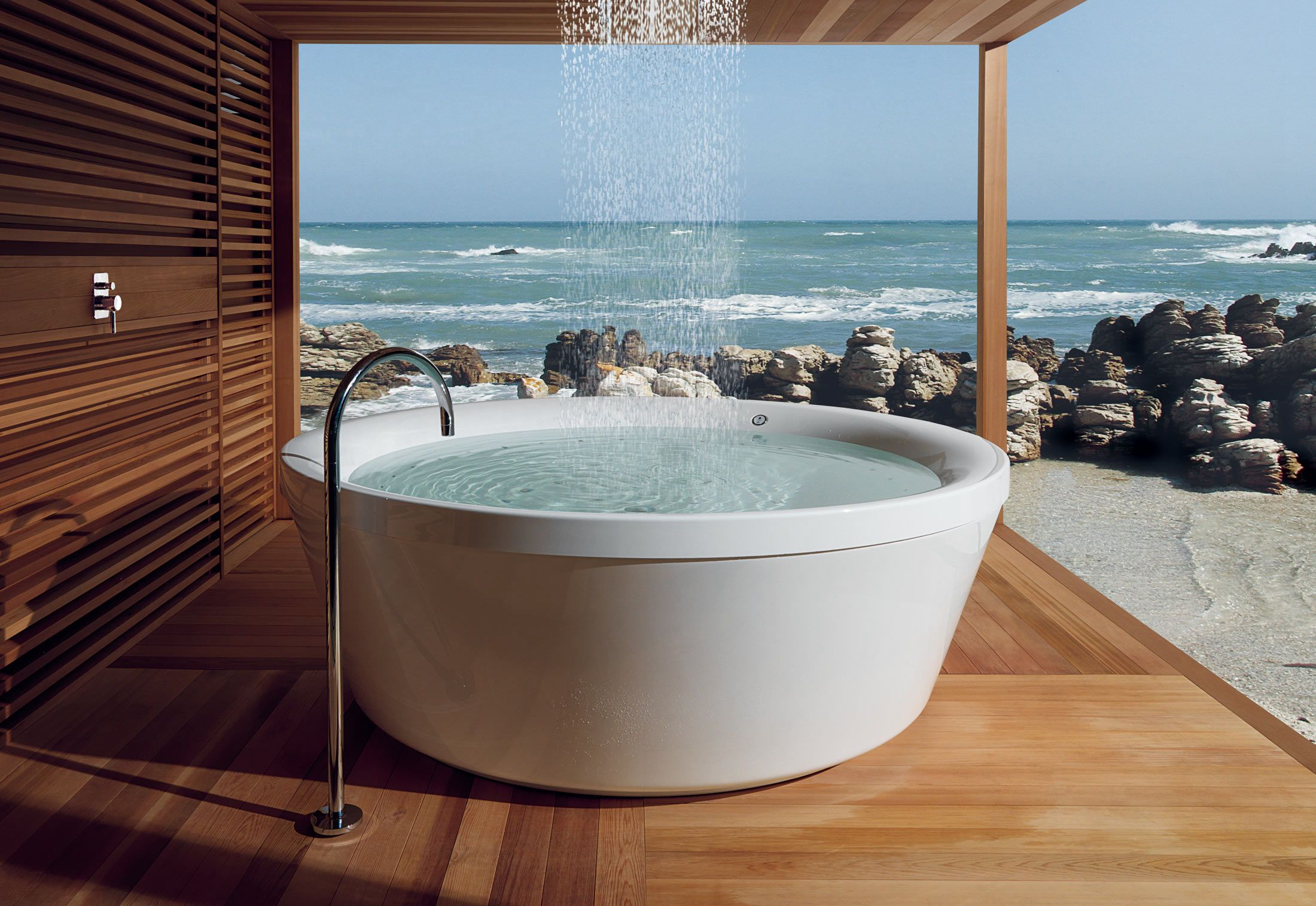 Geo 180 Outdoor by KOS. The rain shower over this grand tub is a ...
