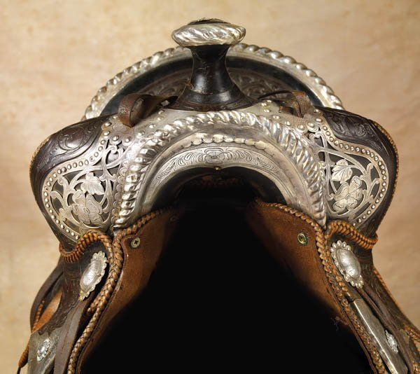 stunning and remarkable silver mounted, floral carved, high back, California saddle adorned with intricate filigreed work on the rear cantle and fork