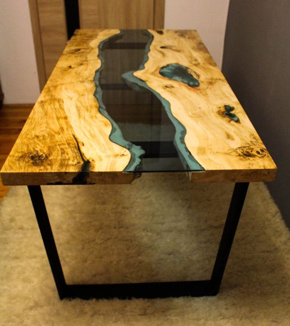 River Table Made Of Old Solid Timber Filled With Blue Epoxy Resin
