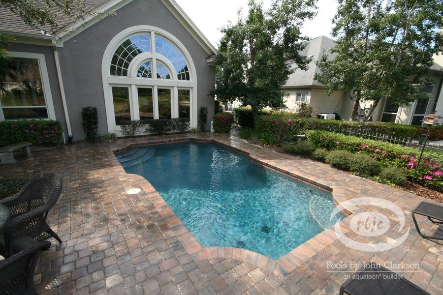 new waterline pool tile, new pebble interior, new paver remodel