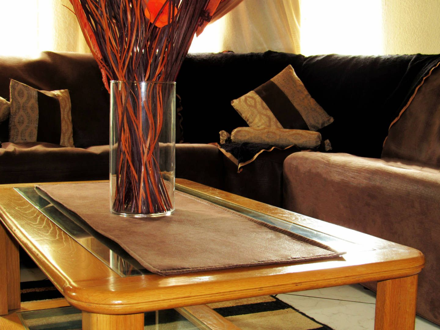 Brown Leather Table Runner With Black Couch Throw Over. A Sweety Cushion  (Neck Support Cushion) And Scatter Cushions