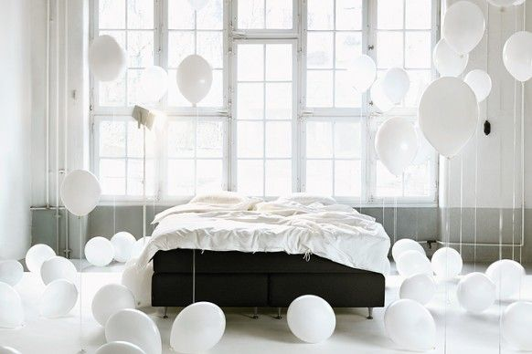 White balloons in the bedroom and other beautiful interior photography from Swedish photographer Pia Ulin