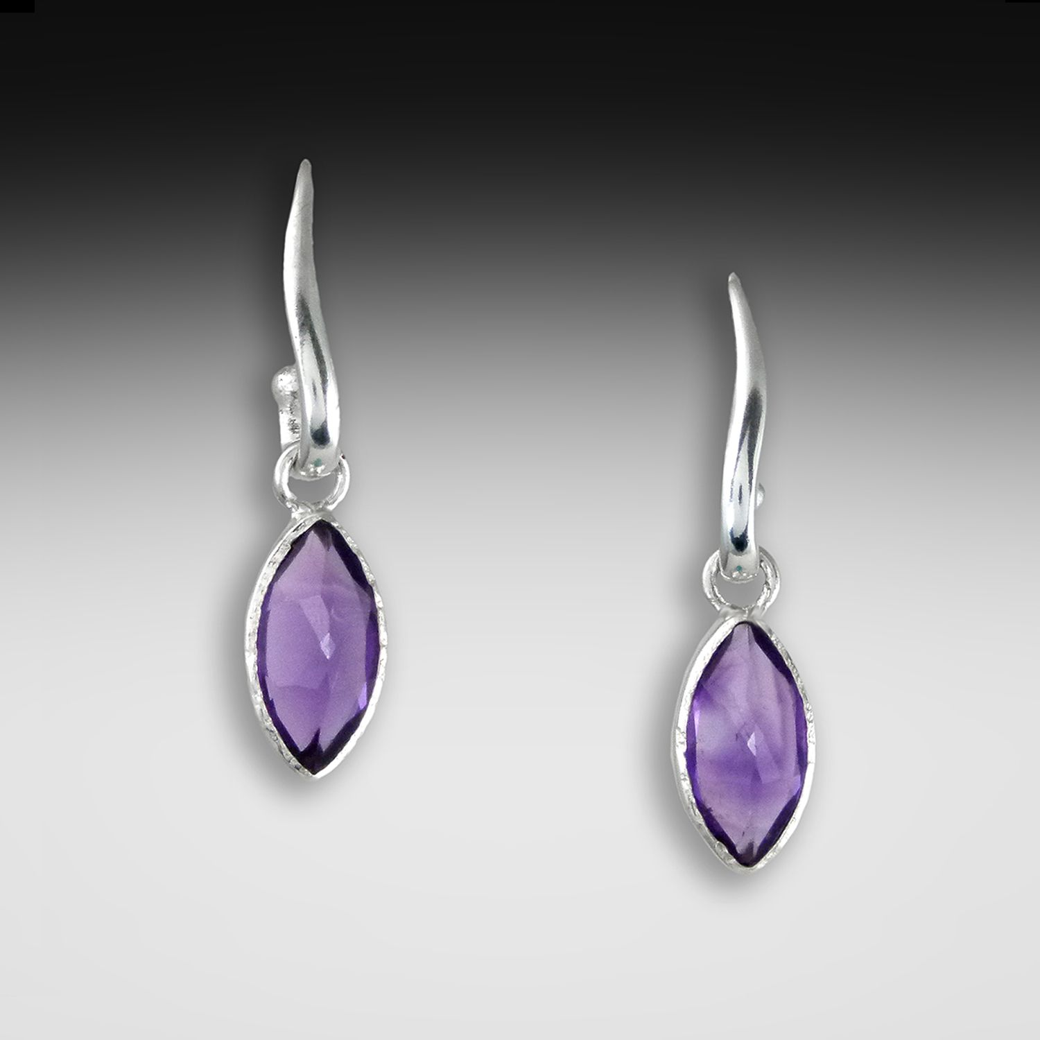 Wavy Post Earrings with Amethyst by Q Evon. American Made. See the designer's work at the 2015 American Made Show, Washington DC. January 16-19, 2015. americanmadeshow.com #earrings, #jewelry, #amethyst, #purple, #sterlingsilver, #americanmade