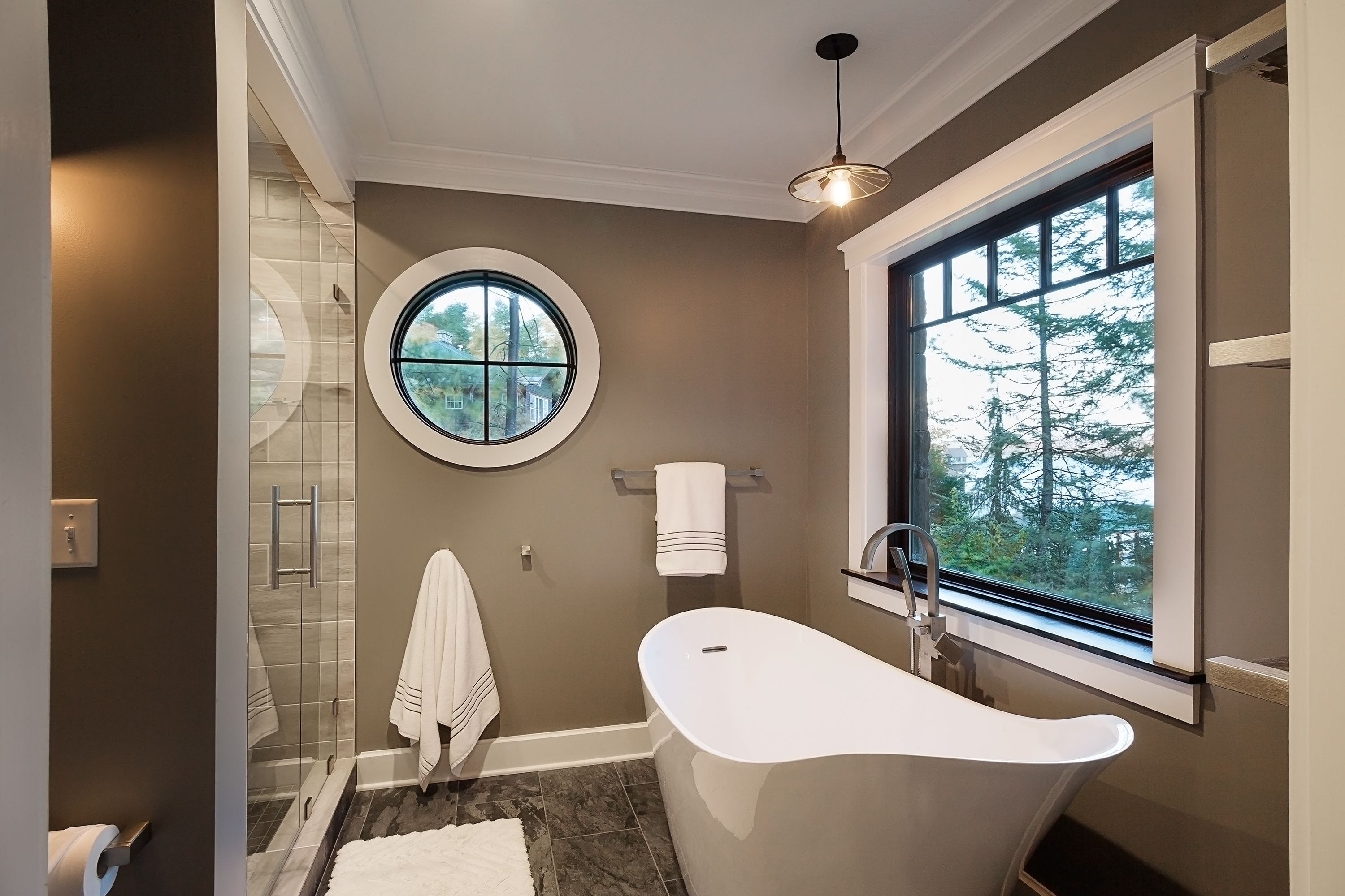 Picture Windows With Black Trim Frame This Beautiful Gray Bathroom By Phinney Design Group Bedroom Makeover House Bathroom Design