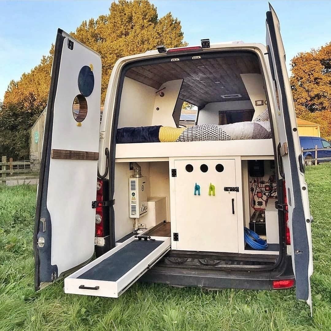 """Photo of ProjectVanlife 🚐 on Instagram: """"A pet-friendly campervan layout. The middle compartment has a dog bed and a slide across door into the van. (Your muddy wet dog can stay in…"""""""