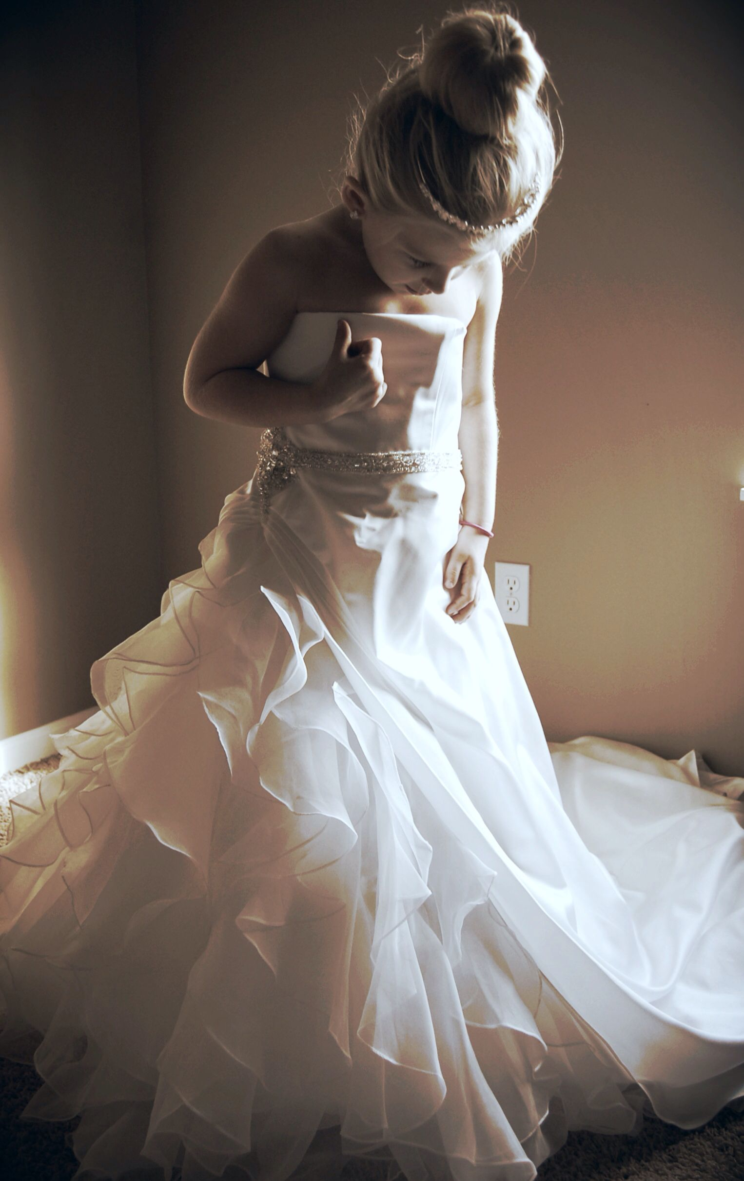 Take a photo of your daughter in your wedding dress then give to