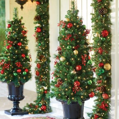 the merry and bright pre lit christmas tree features 33 ornament balls 6 pine cones and 16 realistic red leaves its perfect for a small space such as