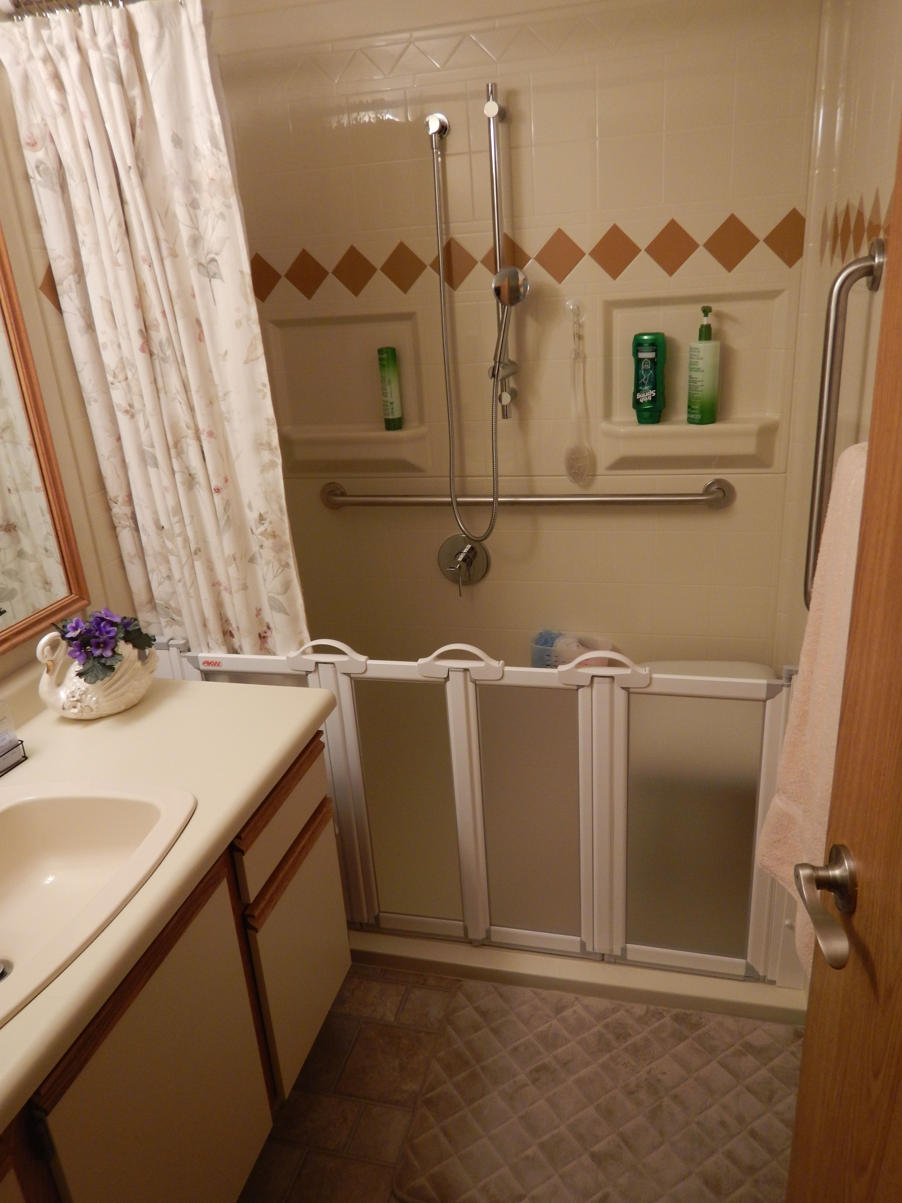 Low threshold shower with accordian folding shower doors that allow ...