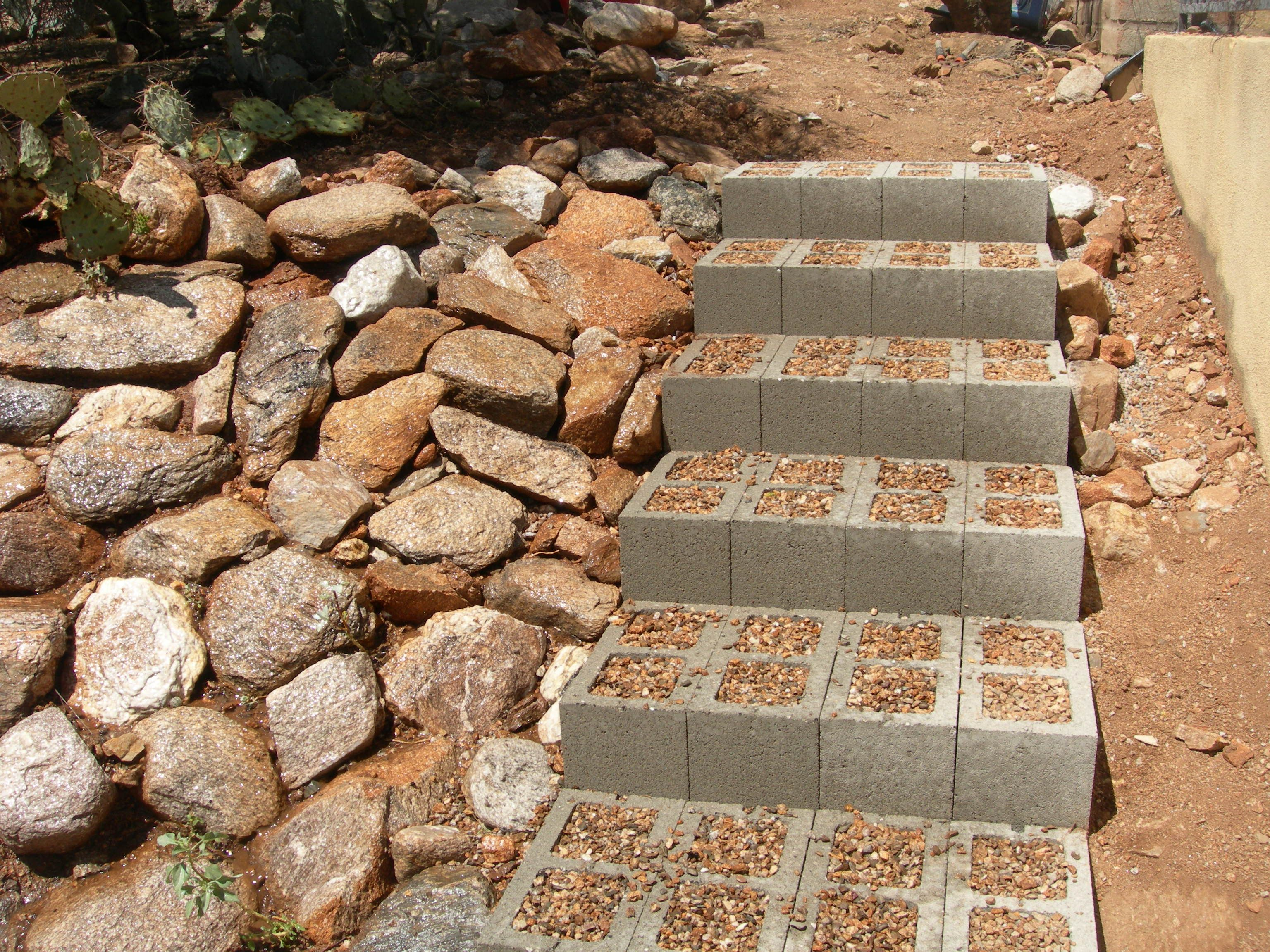 Step-by-step) Cement block steps filled with pebbles... \