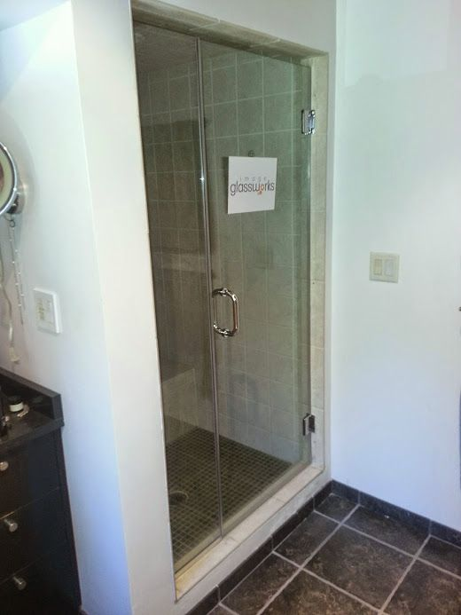 Frameless Shower Door With Chrome Hardware With Channel On The