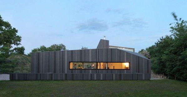 Modern cottage by architectural bureau de zwarte hond modern
