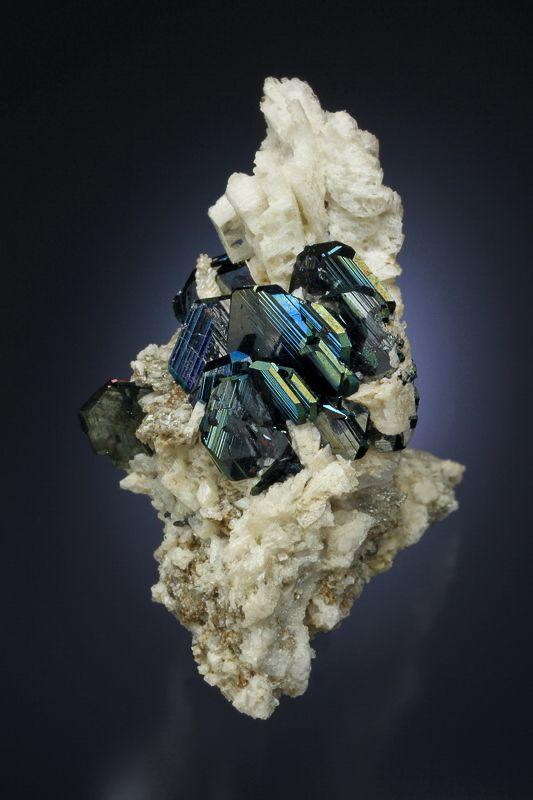 Hematite on Albite - Cavradi gorge, Curnera Valley, Tujetsch, Vorderrhein Valley, Grischun, Switzerland Size: 4.5 x 2.9 x 4.6 cm