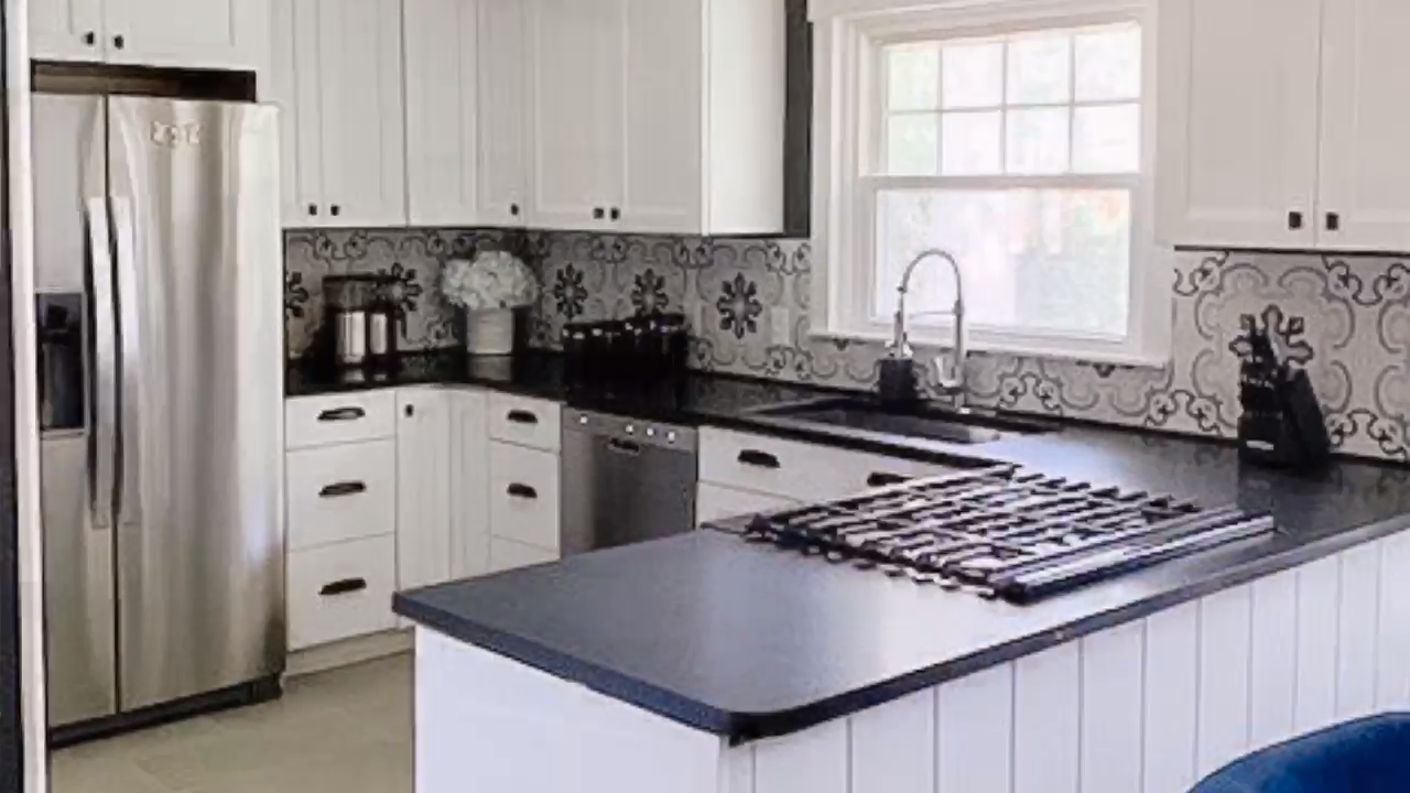 Small kitchen renovation shows that a small kitchen can be beautiful and functional too.  Kitchen was reconfigured to allow for a better flow and updated to a classic black and white design with a splash of modern farmhouse decor.  #kitchenreveal #beforeandafter #kitchenremodel #whitekitchen #kitchenideas #kitchenreno