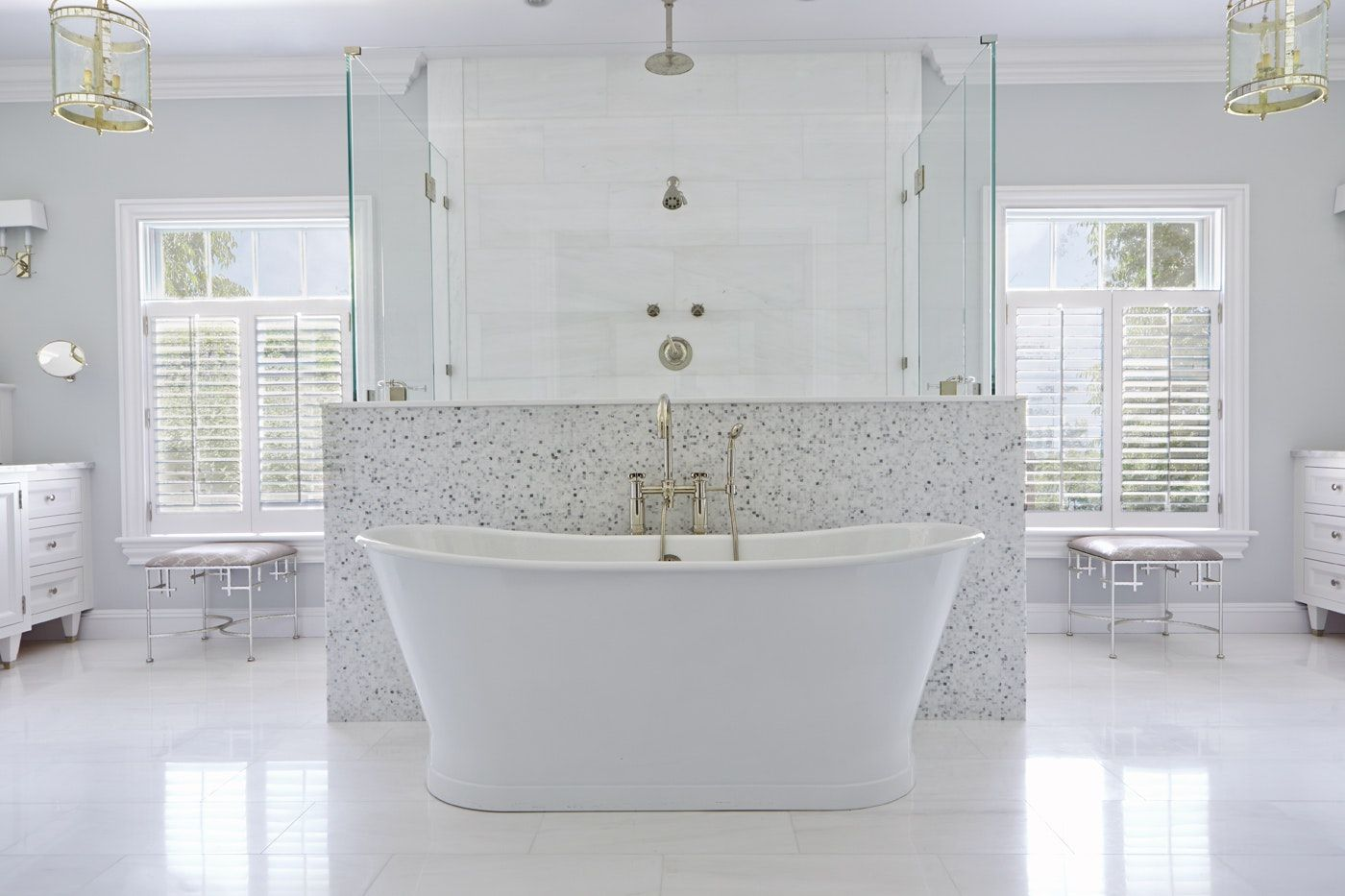 Free standing bathtub double entrance shower behind tub in