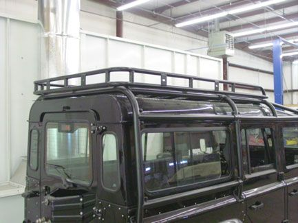 Here you can see the ECR roof rack basket we have fabricated for the 110. It is much more flexible as it will accept any Yakima rack product...