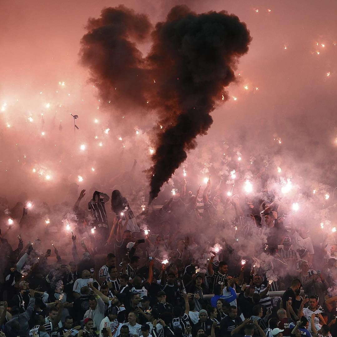 Fans of the Corinthians soccer team light flares prior to a Copa Libertadores match against Uruguay's Nacional in Sao Paulo Brazil on May 4 2016. The match ended in a draw.  Photograph by Andre Penner@ap.images.
