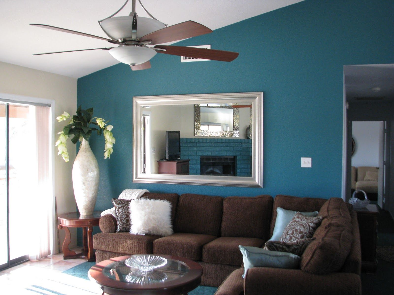 navy blue living room wall will looks harmonious with dark brown