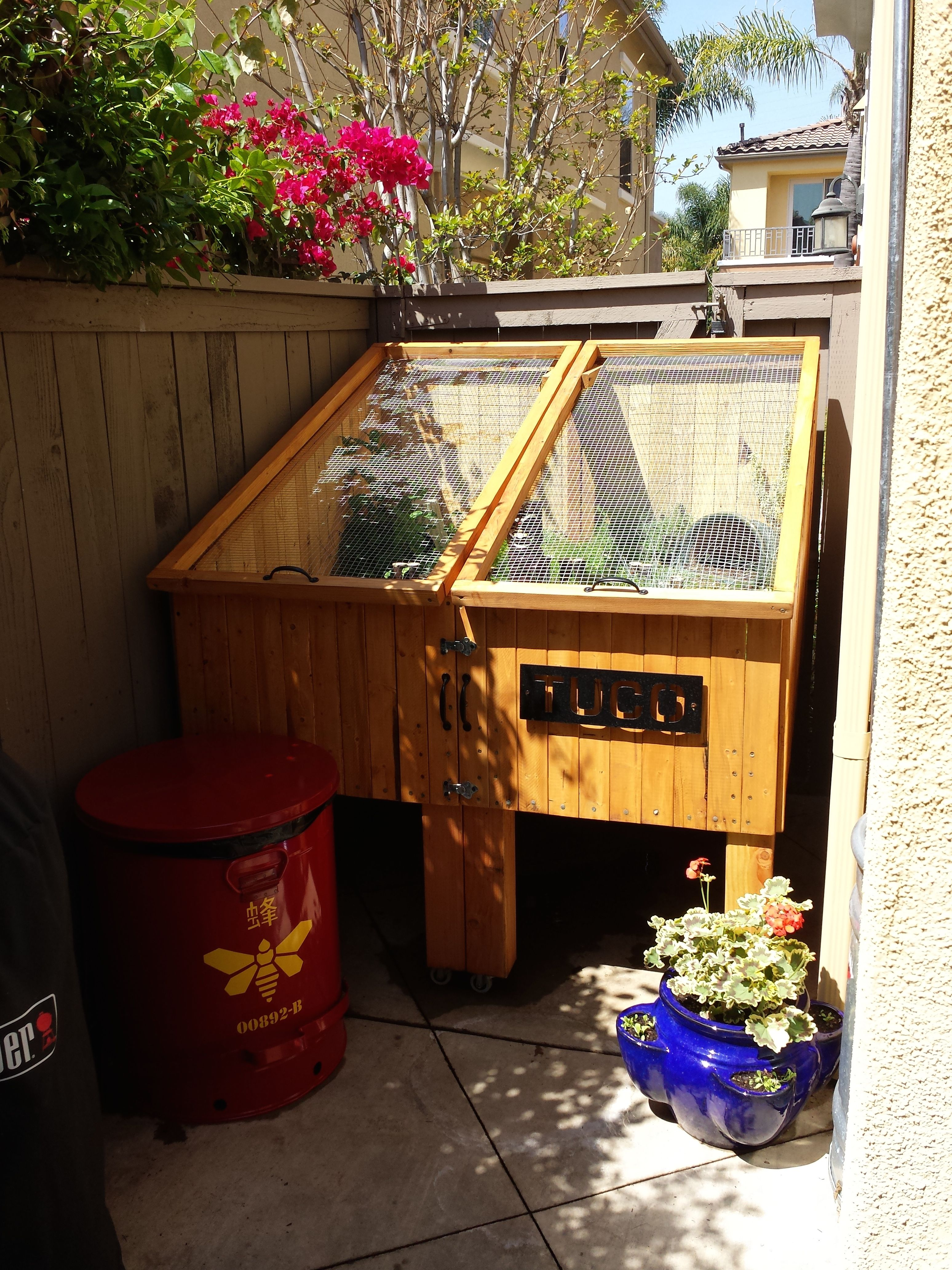 Outdoor tortoise enclosure complete with breaking bad trash can