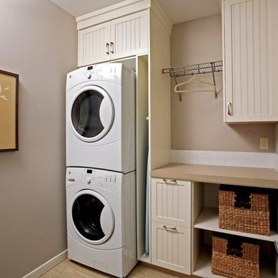 Stackable Washer Dryer And Slot For Ironing Board Laundry Room