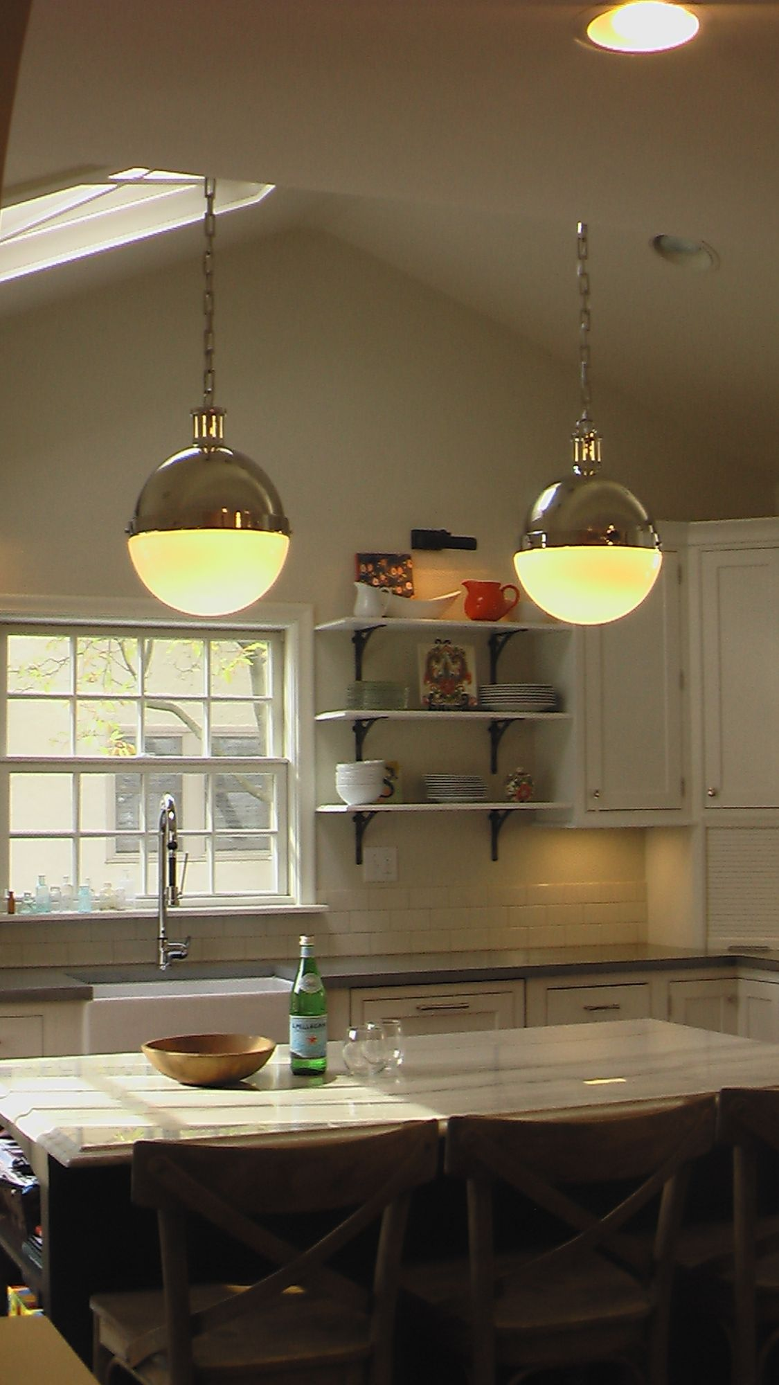 Island with pendant lights and open shelves in background cultivate