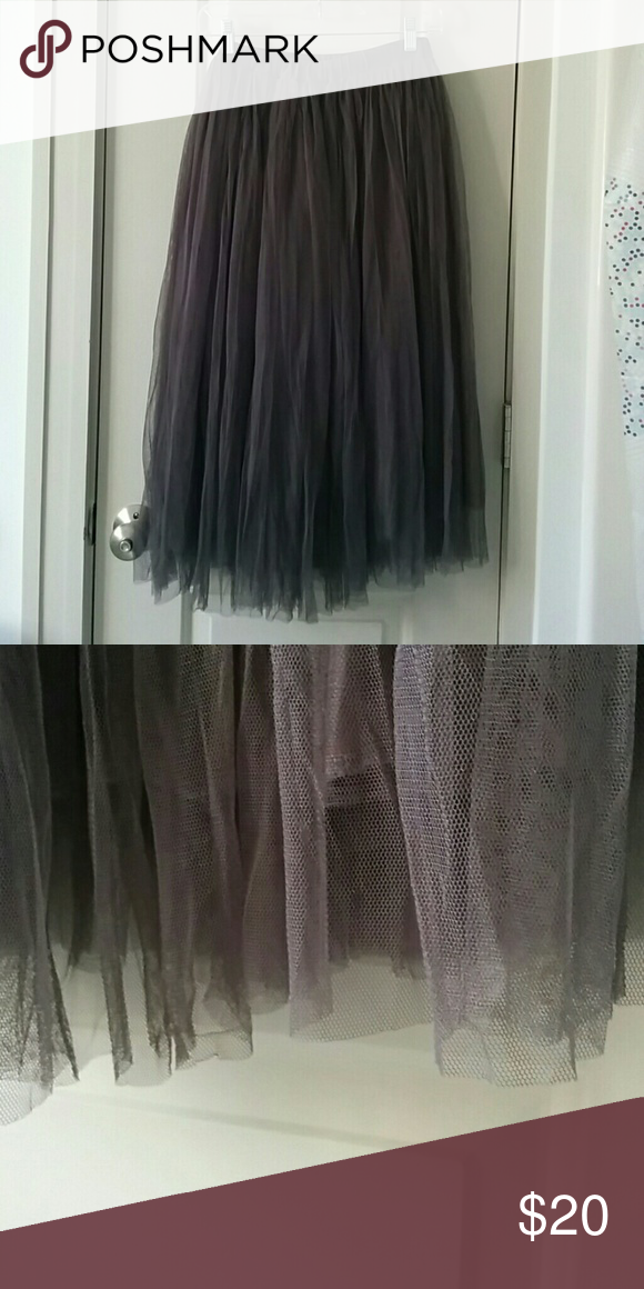 "Gray tulle skirt Bought in Korea, stretch waistband for ""one size fits all"" sizing. I usually wear a size 4 waist and this fits with plenty of extra stretch.   Opaque slip layer with two separate layers of tulle on the outside.   Never wore this out of the house! Skirts Midi"