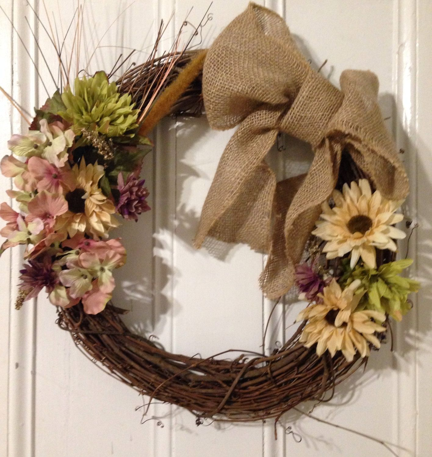 Love this grapevine wreath with the big burlap bow!!