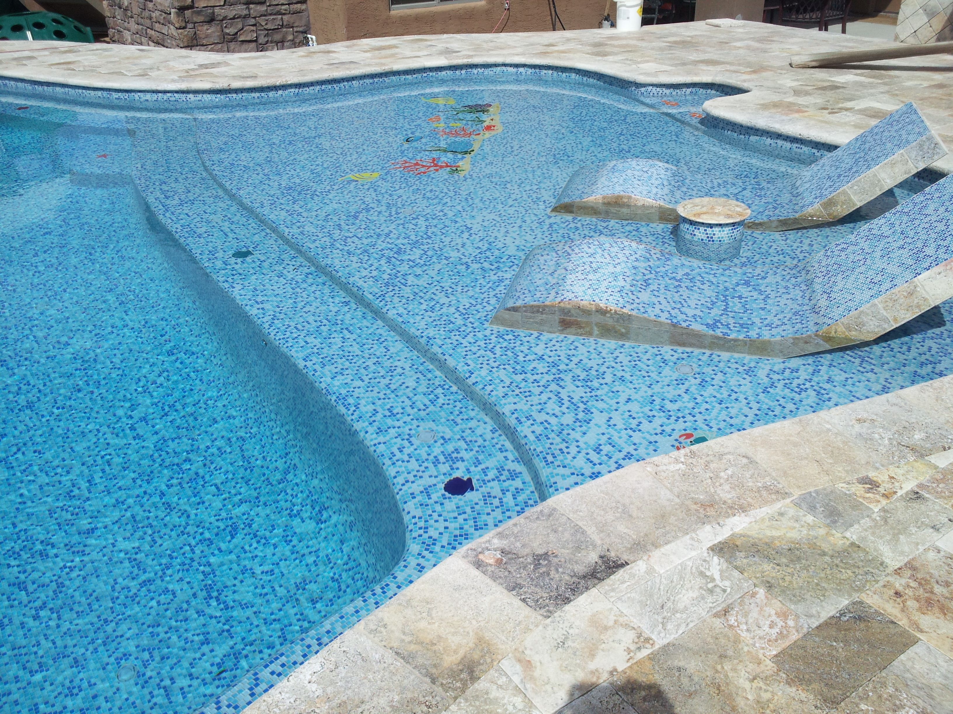 Travertine deck with pool jewelz glass tile interior and for Built in pools