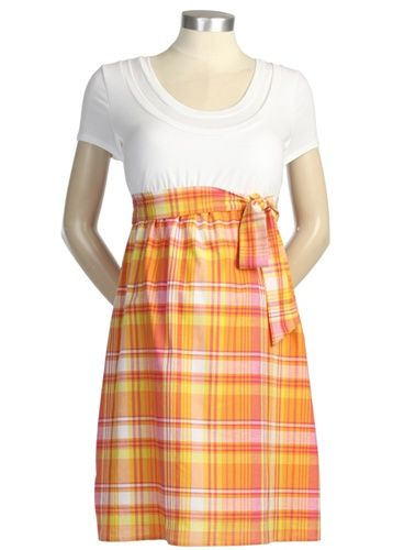 This dress is perfect for spring and is designed to be worn during and after your pregnancy. The knit top has a double neckline for nursing and the woven cotton voile skirt features a decorative waist tie. To nurse, simply pull down the neckline and pull up the built in shelf panel that covers the bust.