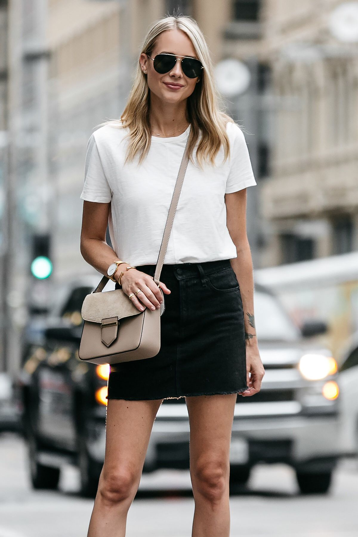 See the cool,girl way to effortlessly style the black denim skirt with just  a simple white t,shirt and mules.