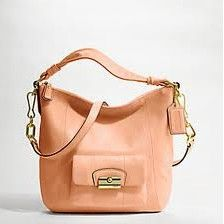 over the shoulder.  Coach, only outlet.  i like this peach color
