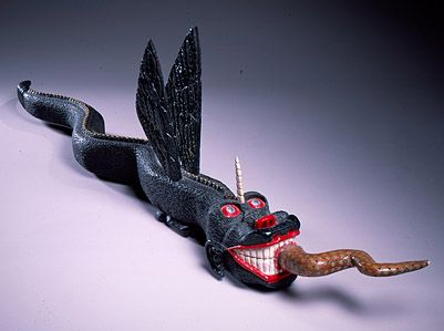 Ulysses Davis | American, 1914 – 1990 | Beast with Wings | ca. 1988 | Painted yellow pine, metal and plastic beads | 39 x 4 1/4 x 11 inches | Gift of James E. Allen in memory of Ulysses Davis | Number: 1991.351