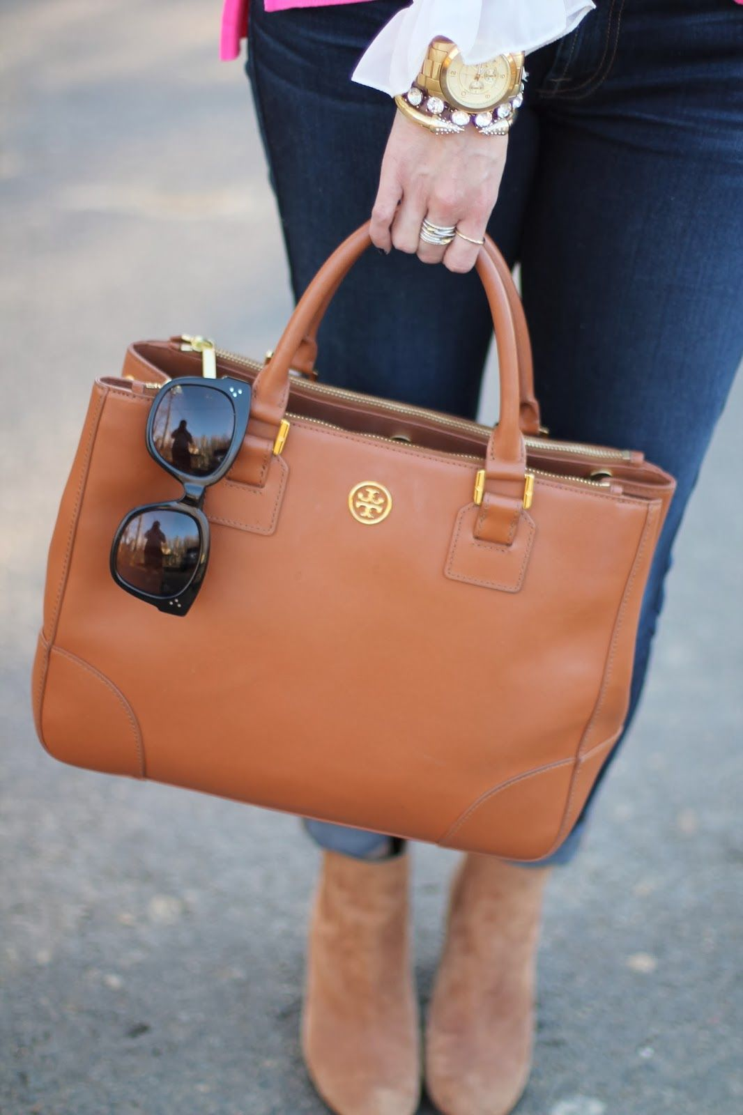Tory Burch is a brand name that people associate that because you own one  you have
