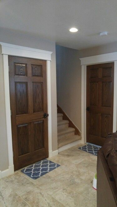 Our completed basement! Dark stained doors with white trim ...