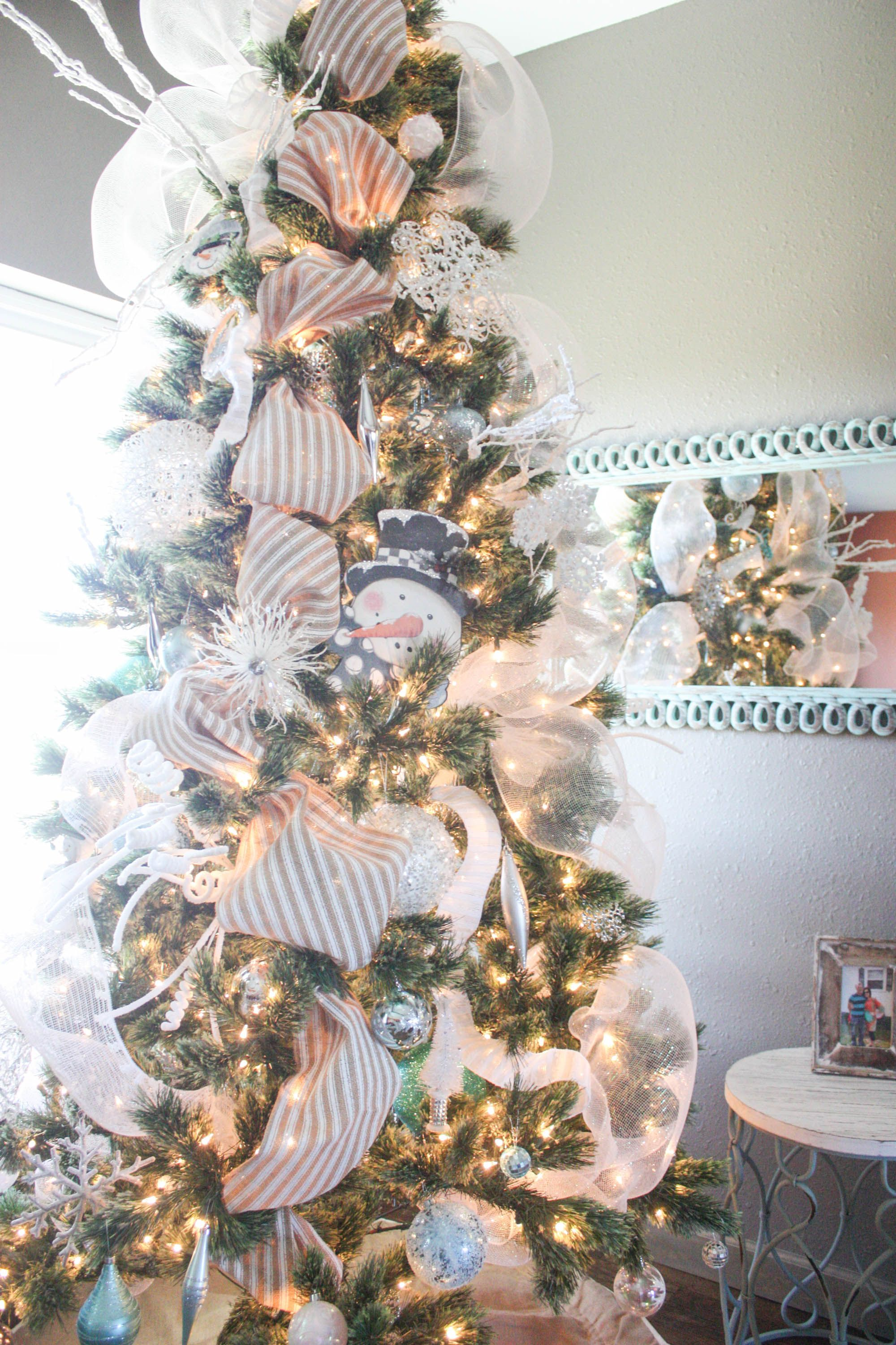 get step by step instructions on how to decorate a christmas tree from start to finish