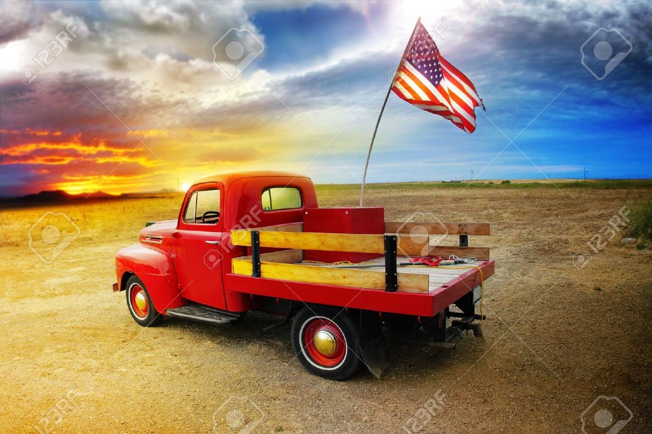 Red Vintage Pick Up Truck With American Flag In Wide Open Country ...