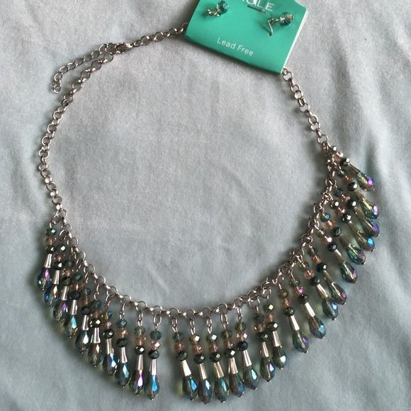 Crystal statement necklace shades of turquoise Beautiful statement necklace shades of turquoise crystals. With matching earrings. Silver tone chain with extender.  NWT Jewelry Necklaces