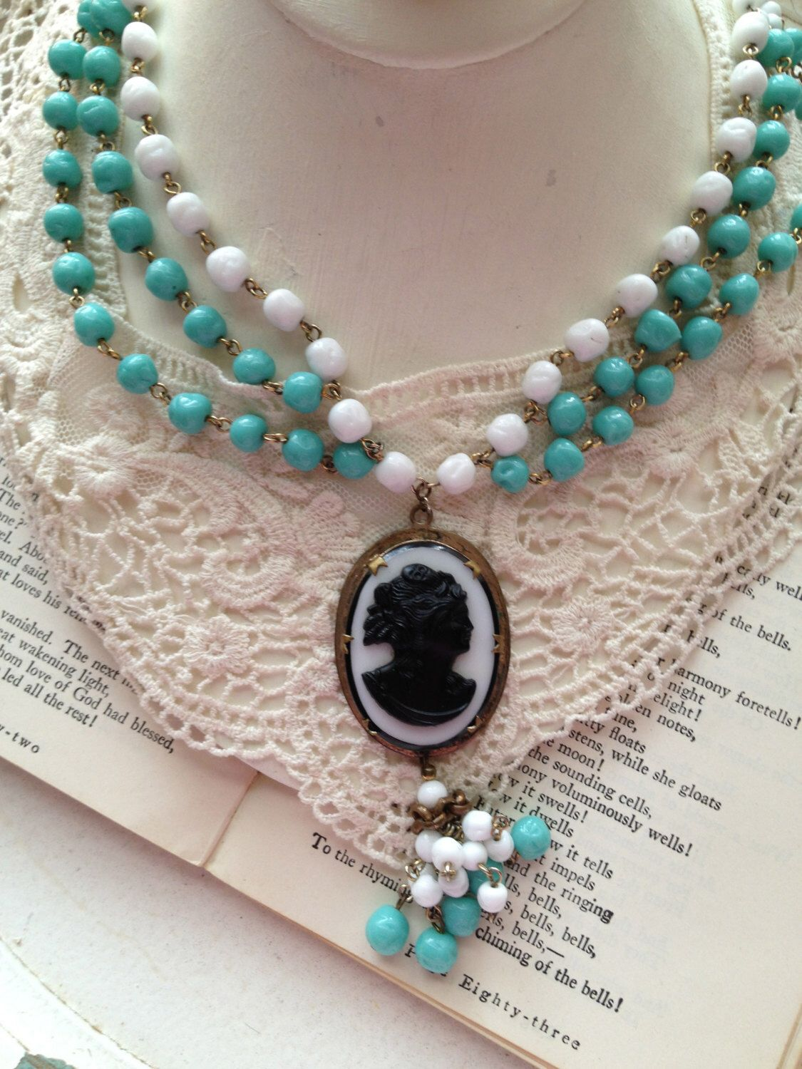 Mystique ... Vintage Assemblage Cameo White and Turquoise Milk Glass Tassle Necklace by VintageJewelryJunque on Etsy https://www.etsy.com/listing/173984943/mystique-vintage-assemblage-cameo-white