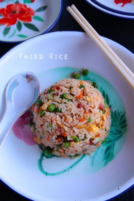 Fried rice. Ingredients: cooked rice, salt, sugar, sesame oil, white pepper, oil, eggs, prawns, Lup Cheong Chinese sausages, bbq pork, onion, carrots, peas, green onion. Recipe on Not Quite Nigella.