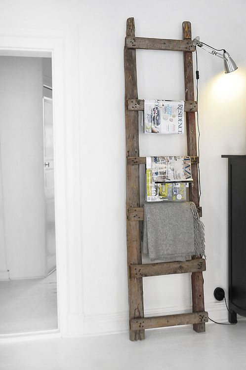 Love this old barn wood ladder to hang stuff.