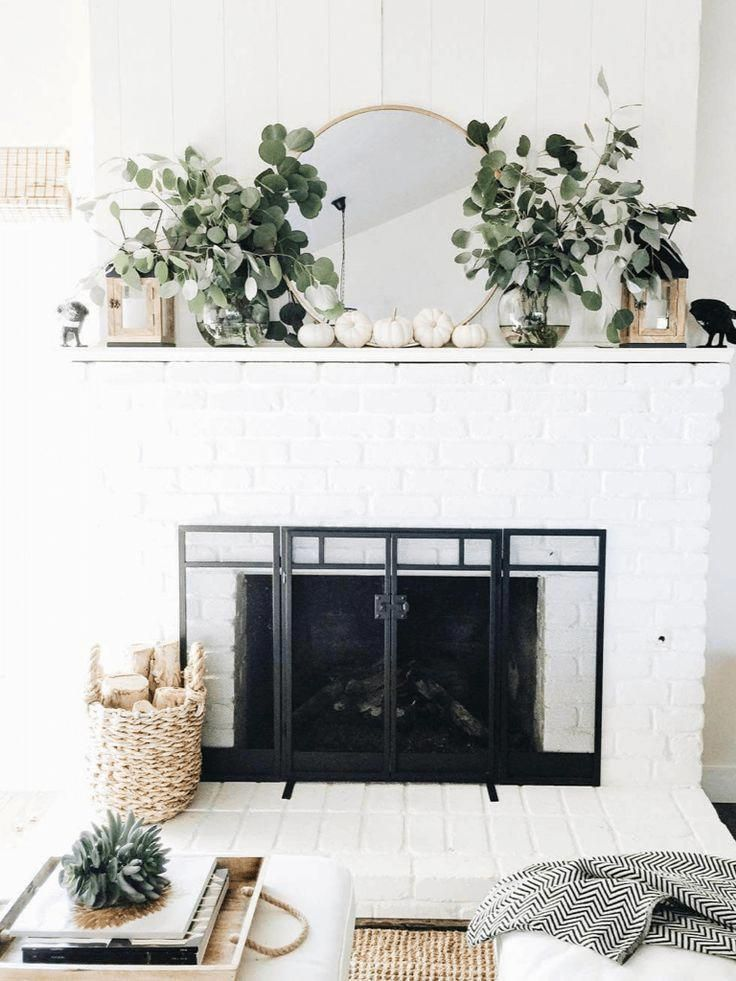 Eucalyptus and white pumpkins, family room, fireplace, fall decor, Fall decor ideas, fall pumpkin, fall mantle ideas, circle mirror on mantle, white pumpkins, minimal decor, fall modern farm house decor ideas #mantleDecorating #fallmantledecor