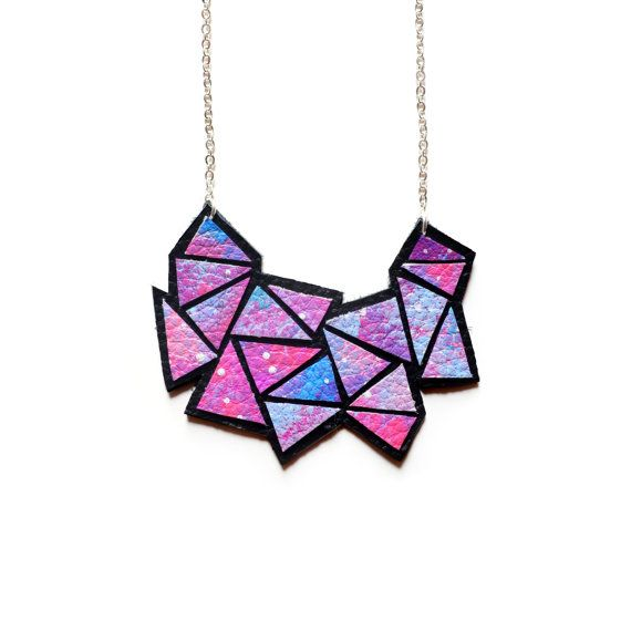 This hand painted abstract colorful design on leather is the perfect colorful addition to your outfit. I hand painted an abstract galaxy pattern