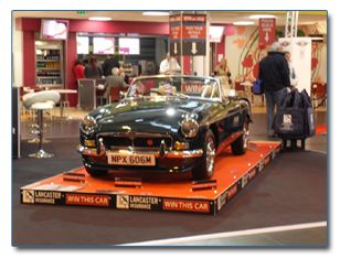 Annoucing the Lancaster Insurance Win an MGB competition at the NEC Classic Motor Show 2011.