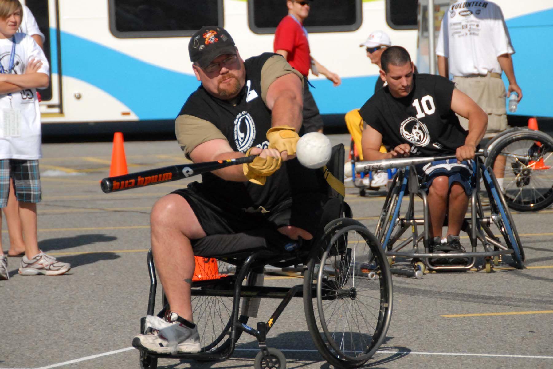 A Man In A Wheelchair Swings A Baseball Bat Sport Rollstuhl