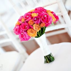 Beautiful pink and coral rose bouquet with crystals to go along with this polka dot wedding!